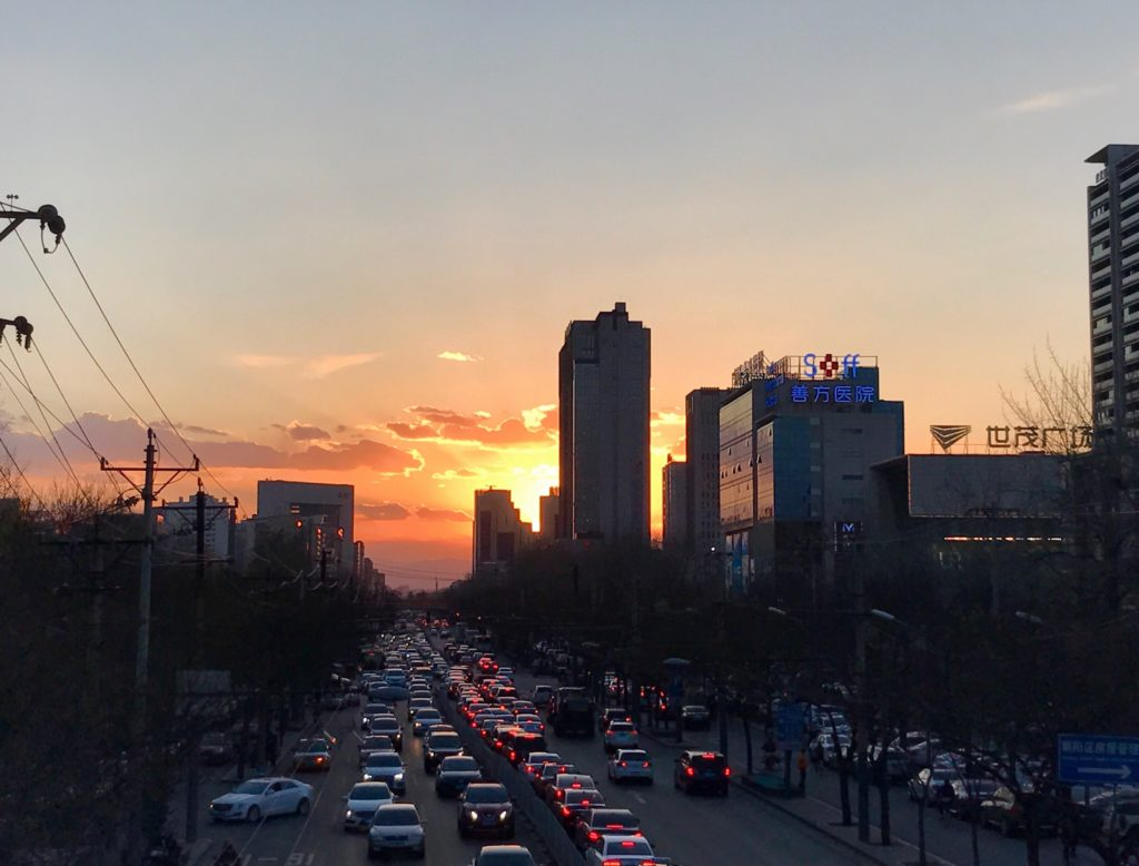 On my way home, I walk pass the noisy Sanlitun area. The sunset is pretty. Photo: Zhao Wenting