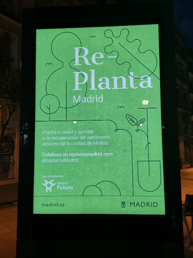 Madridin kaupungin kampanjajuliste puuston uudelleenistutuksen puolesta.